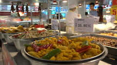 Steamed chicken feet for sale in a Western style supermarket in Shenzhen, China Stock Footage