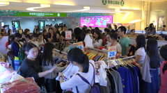 Shopping for bargains at clothing store in Shenzhen, urban lifestyle China Stock Footage