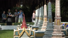 Chinese tourists take pictures of a replica of a Buddhist temple in Bangkok Stock Footage
