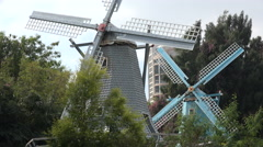 Classic Dutch windmills in Chinese amusement park Shenzhen Stock Footage