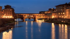 Time-lapse 4k - Night view of Ponte Vecchio, the Old Bridge in Florence, Italy Stock Footage