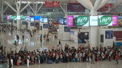 Passengers wait in line at high speed railway station in Shenzhen, China Stock Footage