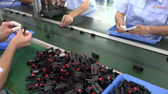 Hand of employees working at assembly line electronic factory in China Stock Footage
