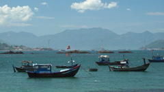 Few fishing boats are shaking on water at the local vietnamese river. Summer Stock Footage