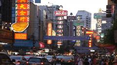 Traffic on Yaowaraj road, Bangkok's Chinatown, Thailand Stock Footage