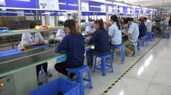 People work on conveyor belt assembly line factory, manual labor China Stock Footage