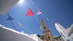 Typical Flags at a church in a grecian village (Lindos, rhodes) Stock Footage