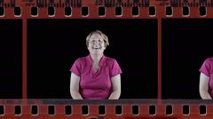 Mature woman showing laughter emotion in film strip Stock Footage