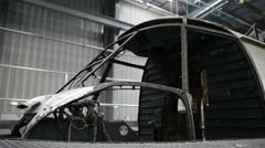 Detail with helicopter fuselage on the repair line in a factory Stock Footage