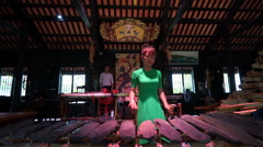 Asian young women dressed long green dress is playing musical instrument Stock Footage