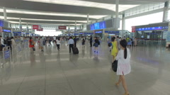 Train passengers walk through the modern Chengdu departure hall China Stock Footage