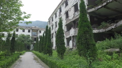 Walking past ruins of collapsed school, Wenchuan earthquake memorial China Stock Footage