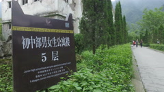 Explanation sign at Wenchuan earthquake memorial in China Stock Footage