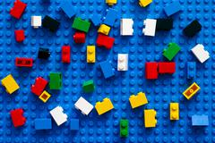 Multicolor Lego Blocks on blue baseplate. Stock Photos