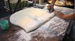 Chef preparing Fried Bread Stick, (youtiao, patongko, Banh Quay) Stock Footage