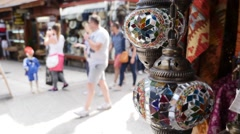 A colorful light lamp and colorful carpets hanging in the old city of Sarajevo Stock Footage