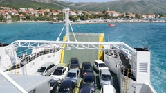 A ferry boat leaving the dock in Orebic, Croatia, and heading to Korcula Stock Footage