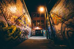 Graffiti Alley at night, in the Station North District, of Baltimore, Marylan Stock Photos