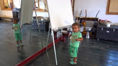 Child is drawing on board in art studio.mp4 Stock Footage