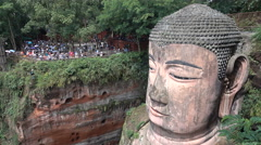 People visit the massive Leshan Giant Buddha in China Stock Footage