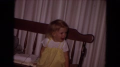 1970: a child is seen posing sitting on a bench WHITE SANDS, FLORIDA Stock Footage