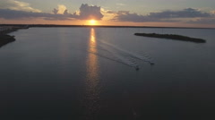 Aerial view of Intercoastal Waters with Speedboats at Sunrise Stock Footage