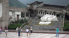People visit memorial site at collapsed school Wenchuan earthquake China Stock Footage