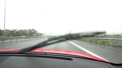 Windscreen wipers cleaning car window Stock Footage