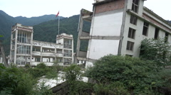Collapsed school buildings at Wenchuan earthquake memorial site in China Stock Footage