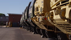 Military Vehicles Parked in Motorpool Stock Footage