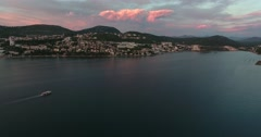 Aerial footage of the city Neum in Bosnia-Herzegovina, with a boat floating Stock Footage