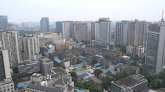 View of commercial office towers and residential buildings in Chengdu, China Stock Footage