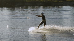 Wakeboarder making tricks on sunset Stock Footage