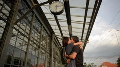 Happy couple embracing on railway station platform. Farewell at the train Stock Footage
