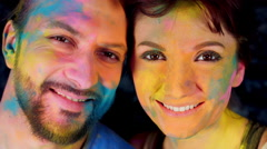 4k Colourful LGBT Shot of a Couple in Holy Powder Smiling Stock Footage