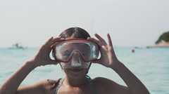 Little girl in mask dive into the water in the sea. 4K Stock Footage