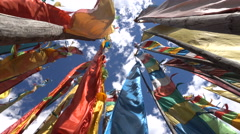 Abstract view (looking up towards the sky) of traditional Tibetan prayer flags Stock Footage