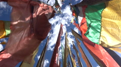 Colorful Tibetan prayer flags near a small monastery in Sichuan province, China Stock Footage
