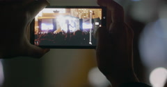 In MSU, Moscow on a concert of musical group Kino man took a photo on mobile Stock Footage
