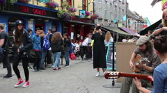 IRELAND AUGUST 2016 Street Musician Performing in Town of Galway Stock Footage
