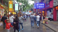 Walking through a popular food street in Muslim district Xi'an (steadycam) Stock Footage