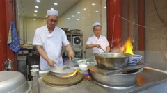 Chinese Muslim chefs prepare food in popular restaurant Xi'an Stock Footage