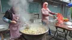 Women prepare fresh soup in small mosque in Xian, China Stock Footage