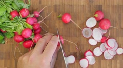 Slicing radish on a rustic wooden table - flay lay 4K Stock Footage