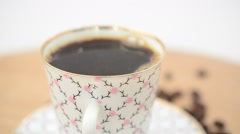 Closeup of Coffee, coffee cup and grains. Stock Footage