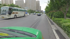 Driving a taxi through streets of Xian, China Stock Footage