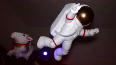 Figure of white astronaut suspend in air. Indoor. doll Stock Footage