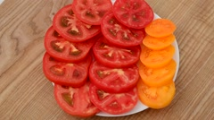 Tomatoes pieces on a plate. Stock Footage