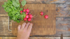 Slicing radish on a rustic wooden table - top view 4K Stock Footage