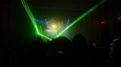 Green beams from floodlights in crowded nightclub . Audience. Laser show Stock Footage